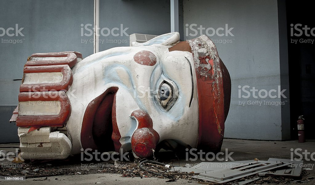 Scary abandoned clown head stock photo