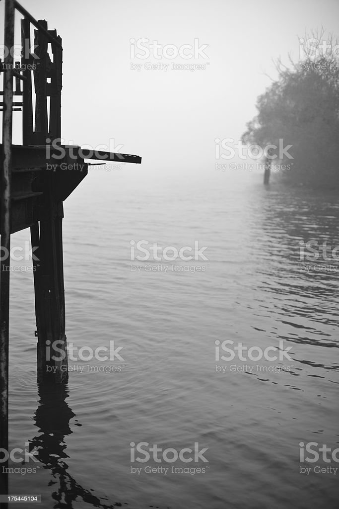 Scary and Mysterious Fogs over Placid River royalty-free stock photo