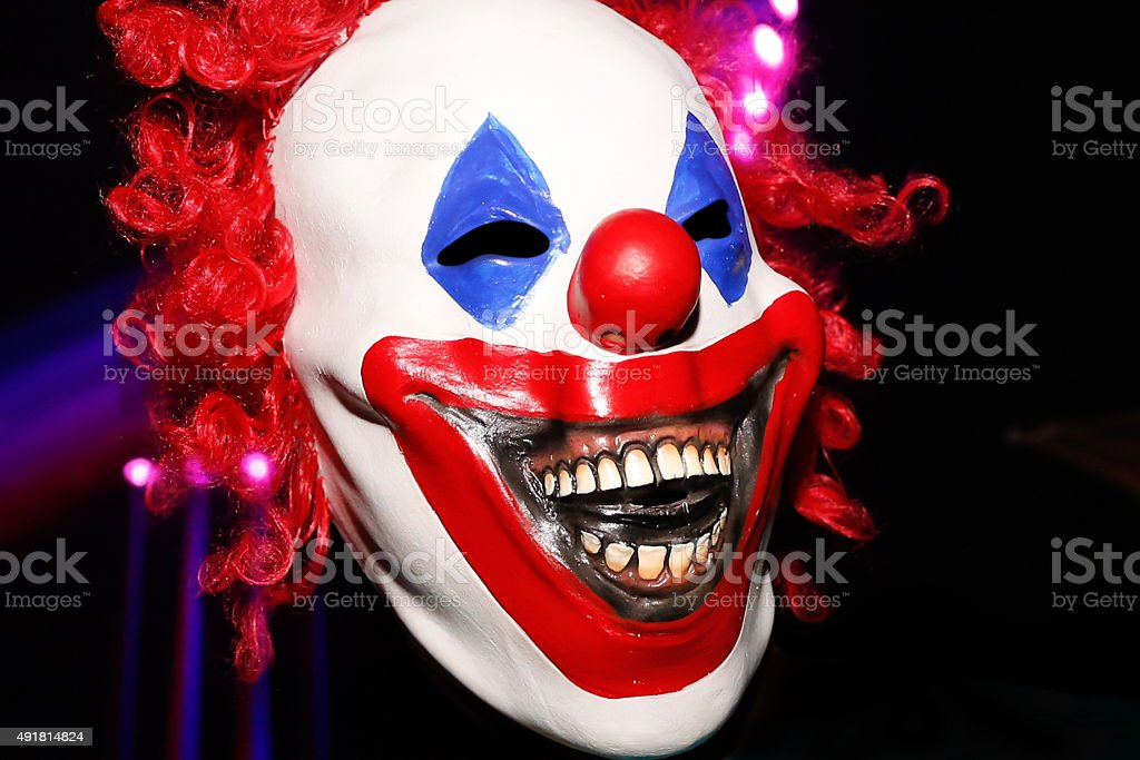 Scary clown mask costume halloween stock photo