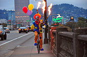 Scary Clown Riding a Unicycle Playing Flaming Bagpipes in Portland