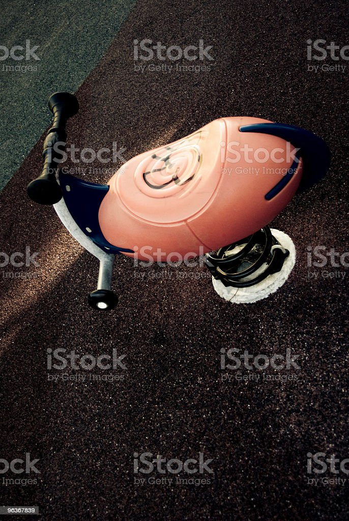 Scary dark and deserted playground with old rides stock photo