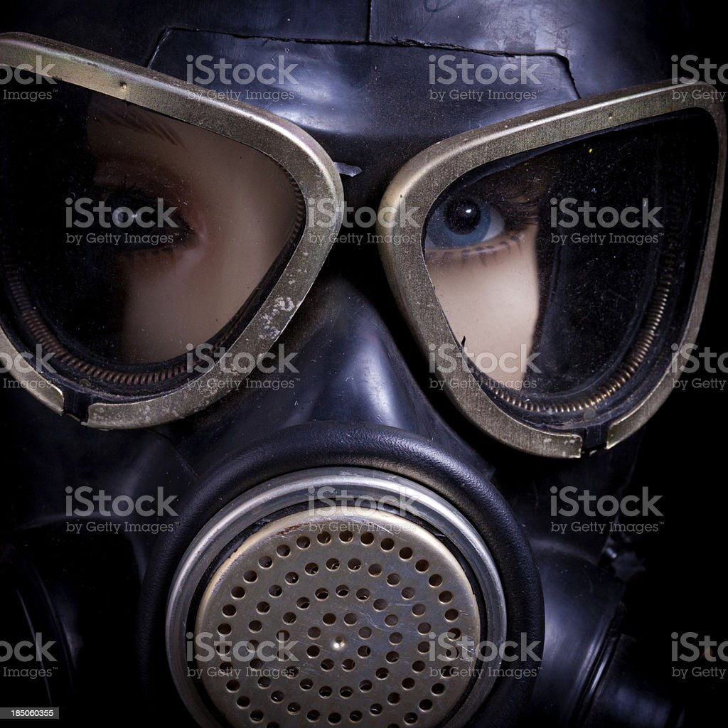 Scary dummy's eyes hidden by gas mask stock photo