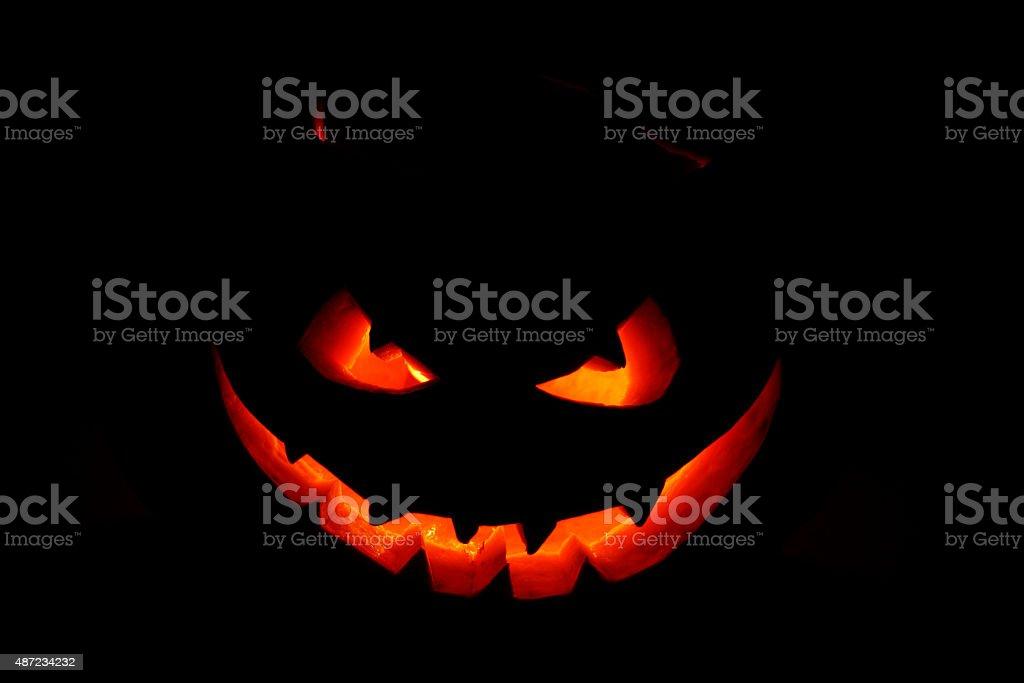 Scary face of Halloween pumpkin stock photo