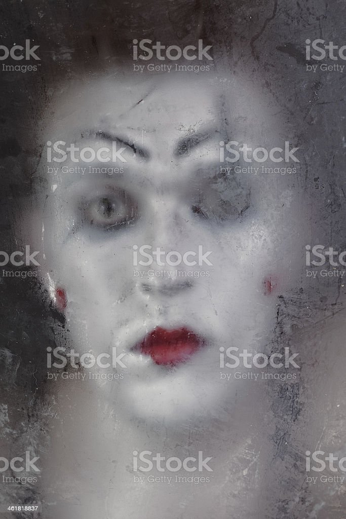 Scary face screaming mime for murky glass royalty-free stock photo