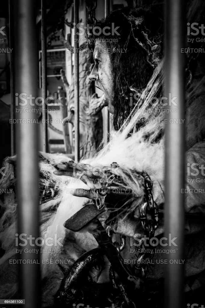 Scary figure at a haunted house at a folk festival in Regensburg in a cage stock photo