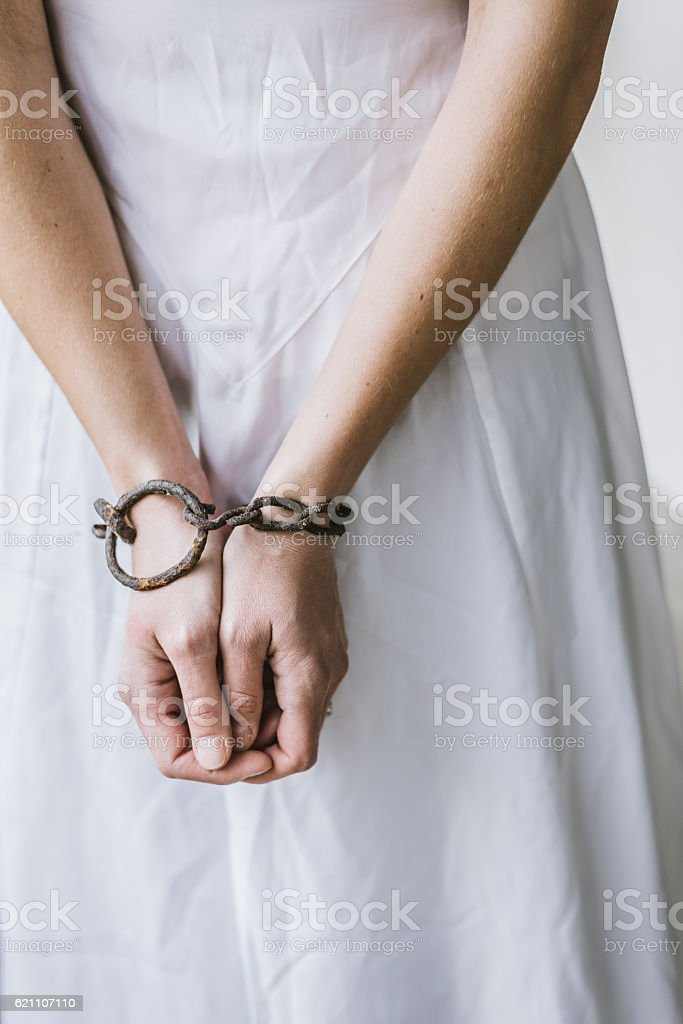Scary girl ghost , old, rusty chain stock photo