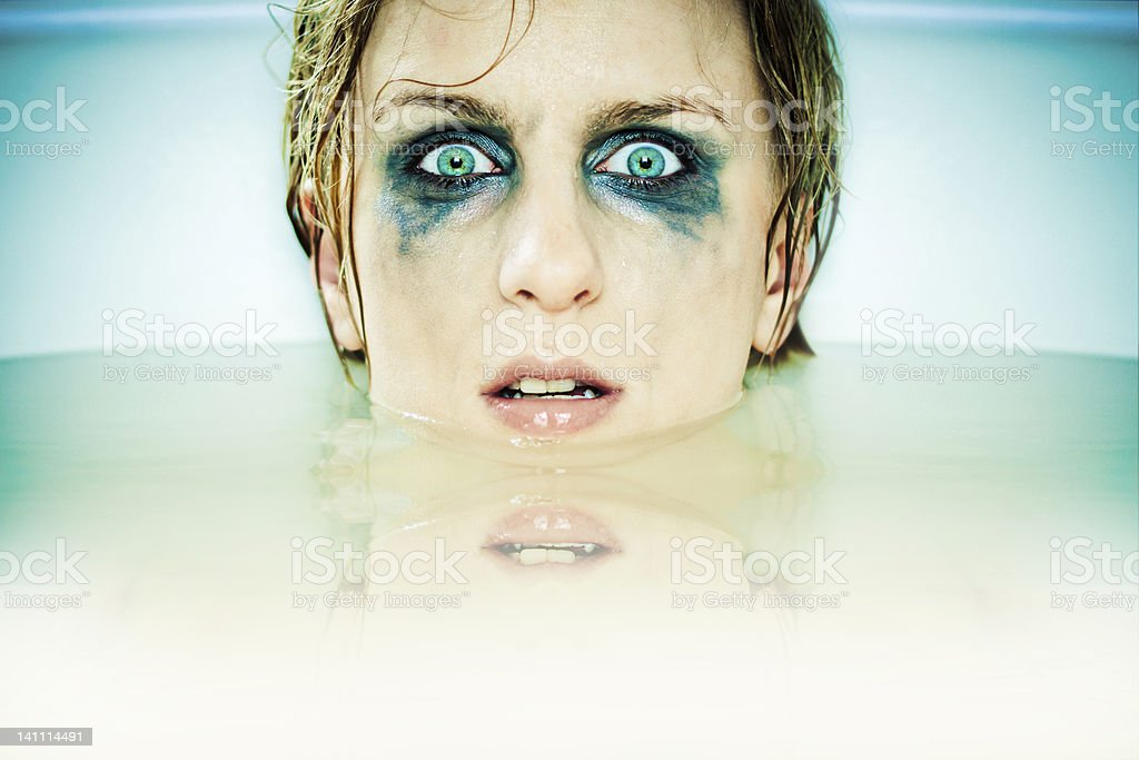 Scary girl in bath royalty-free stock photo