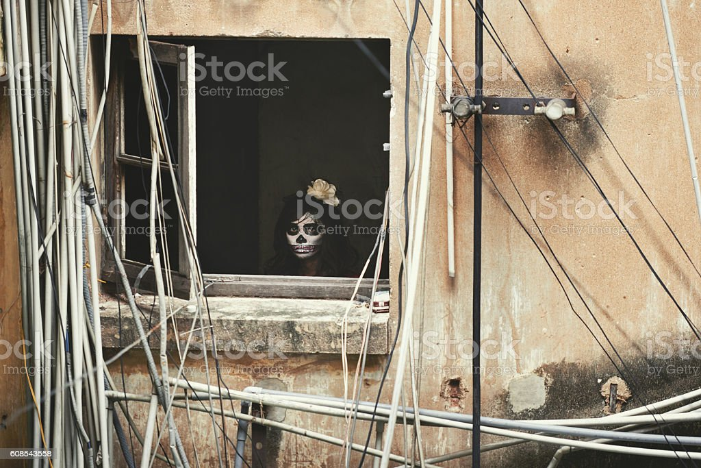 Scary girl in window stock photo