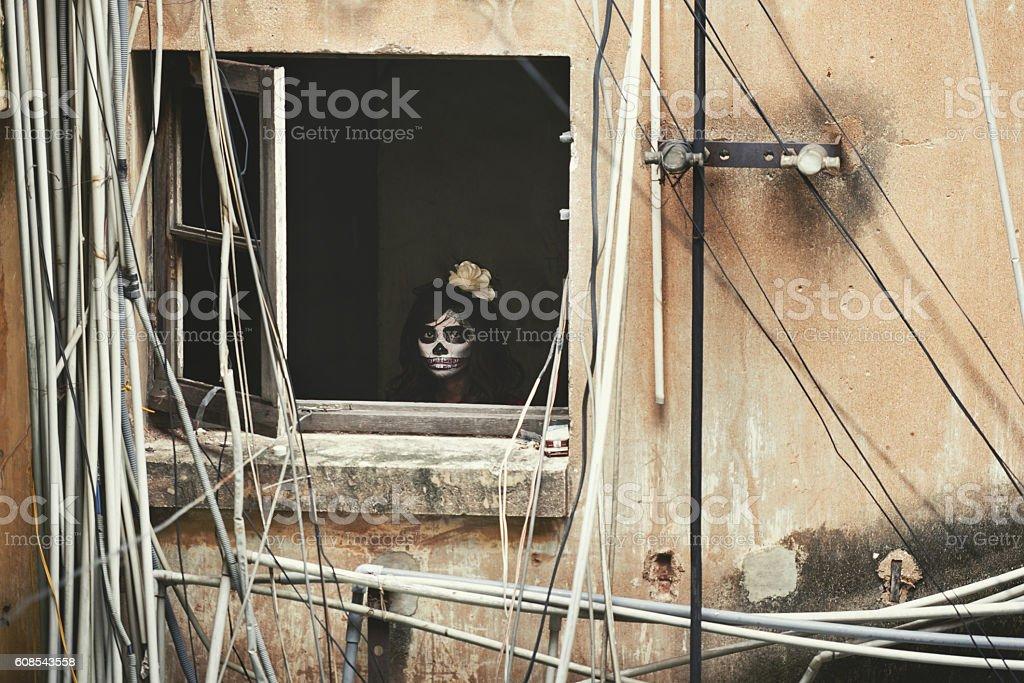 Scary girl in window stock photo
