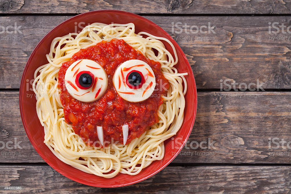 Scary halloween food pasta vampire monster face with big eyes stock photo