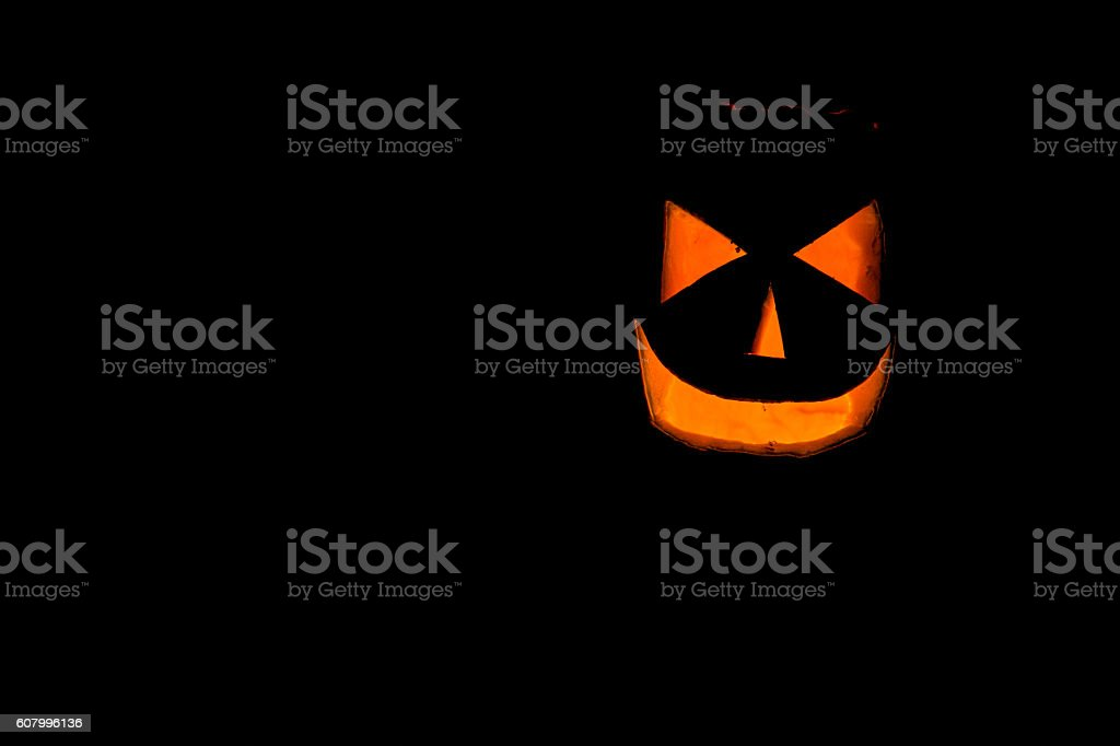 Scary Halloween pumpkin isolated on a black background stock photo