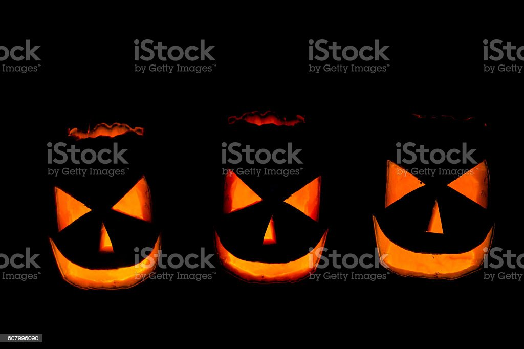 Scary Halloween pumpkins isolated on a black background stock photo