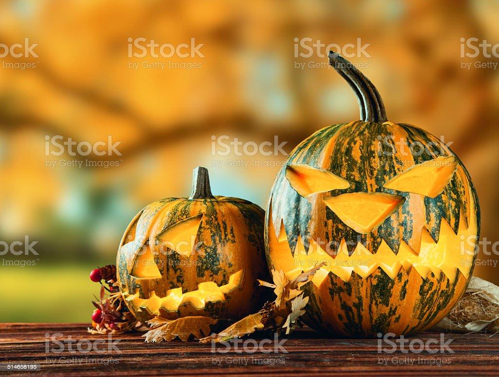 Scary hallowen pumpkin on wood stock photo