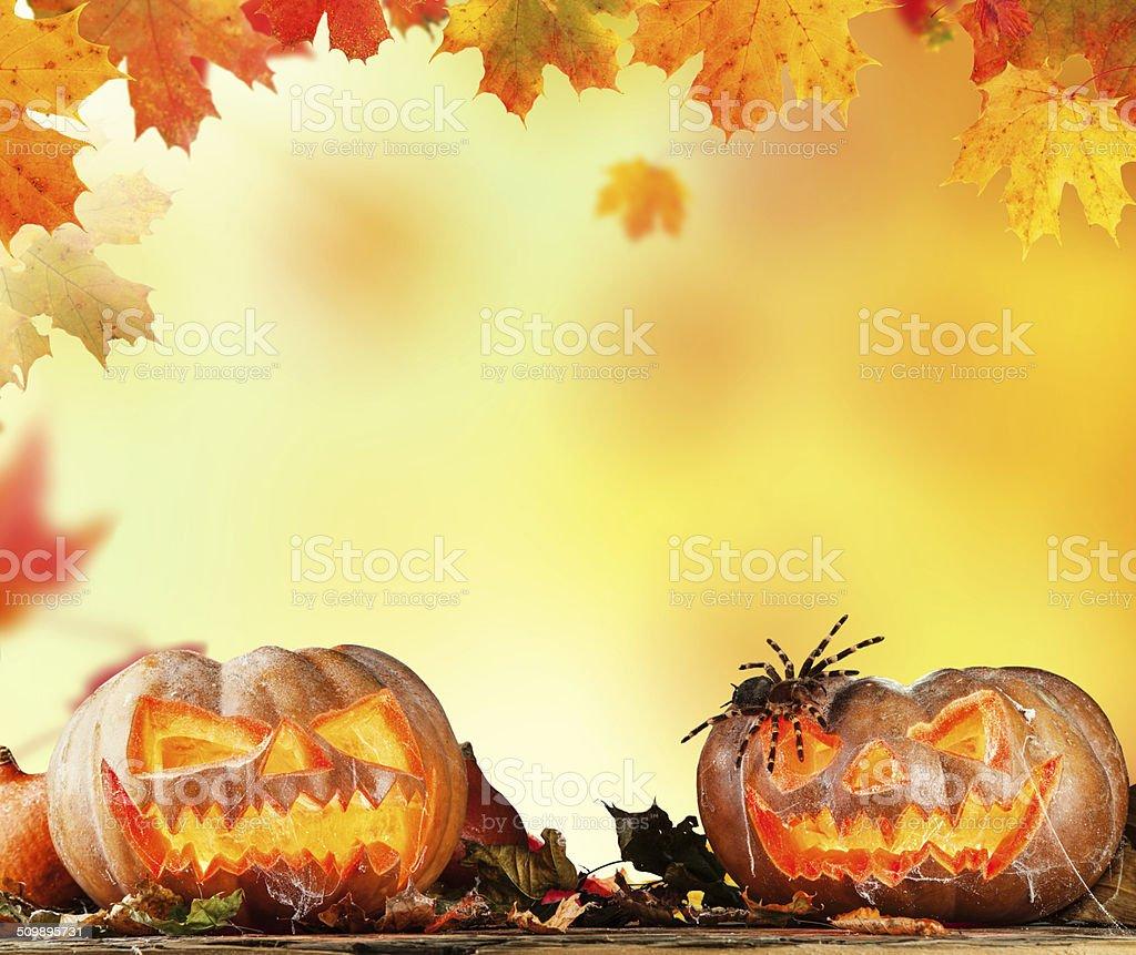 Scary hallowen pumpkins on wood stock photo