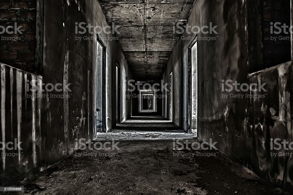scary hallway walkway in abandoned building stock photo