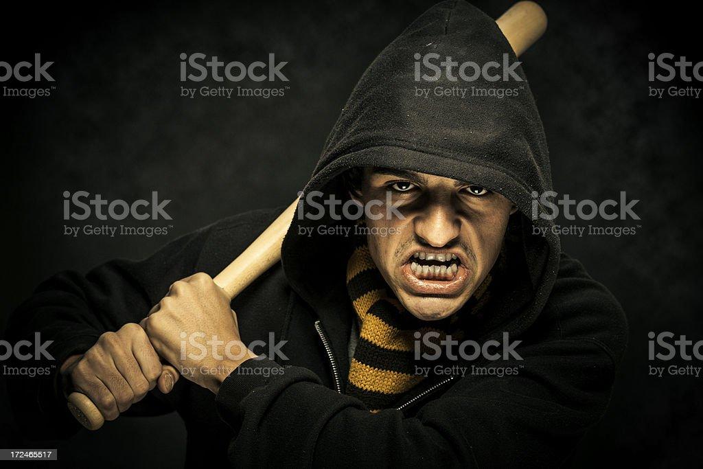 Scary hooded man with baseball bat royalty-free stock photo
