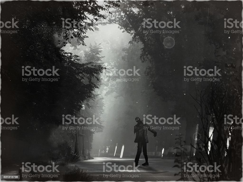 Scary horror zombie standing in night landscape stock photo