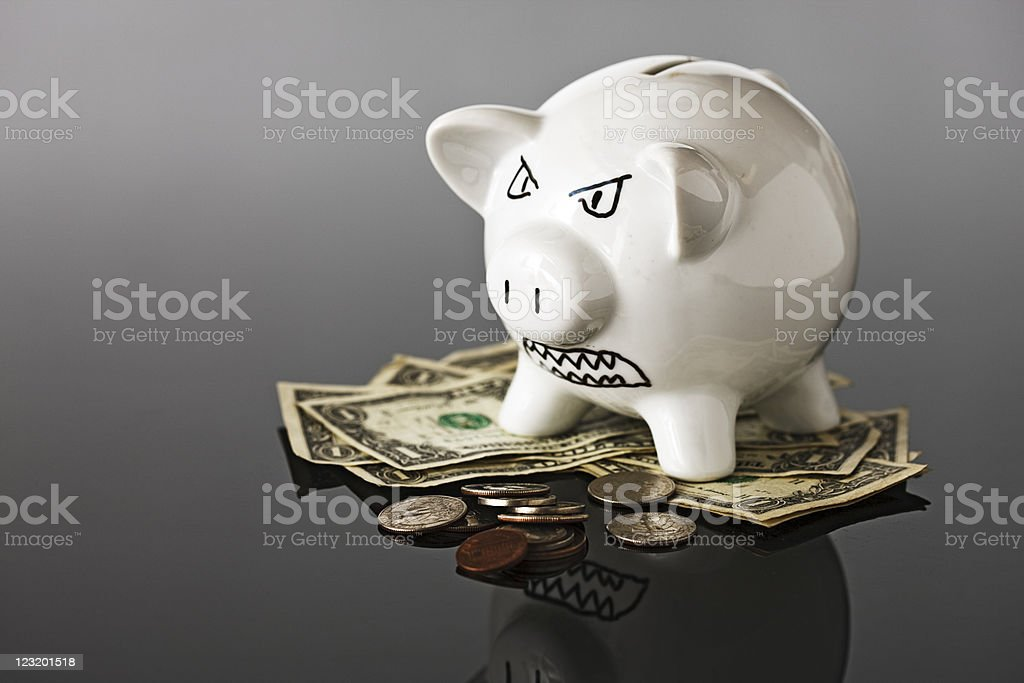 Scary looking piggy bank guards US currency royalty-free stock photo