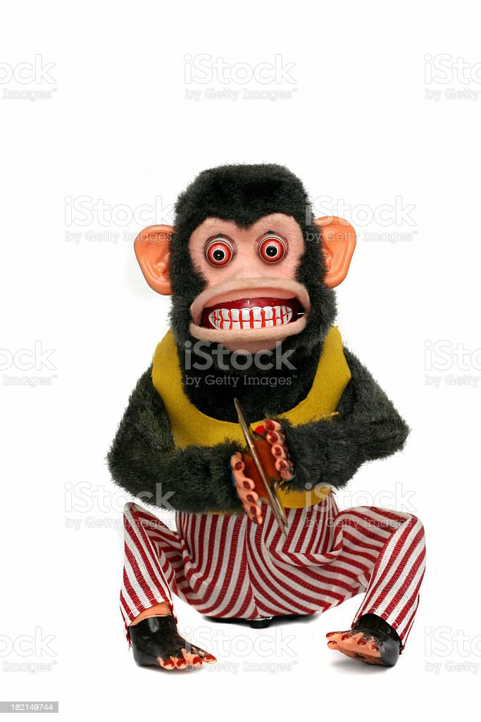Scary looking vintage monkey in clothes playing cymbals royalty-free stock photo