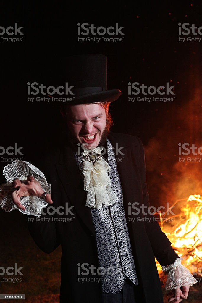 Scary magician in front of fire stock photo