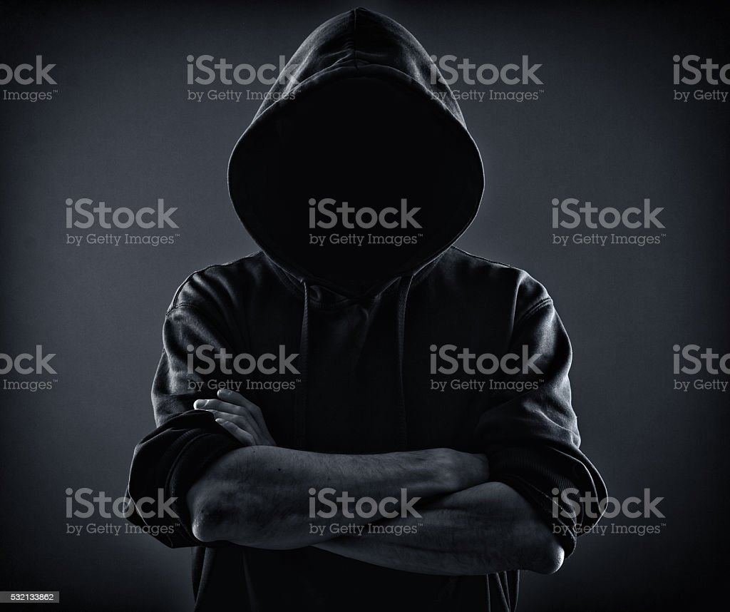 scary man in a hood stock photo