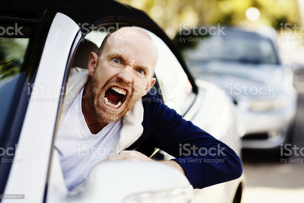 Scary man is filled with uncontrollable road rage stock photo