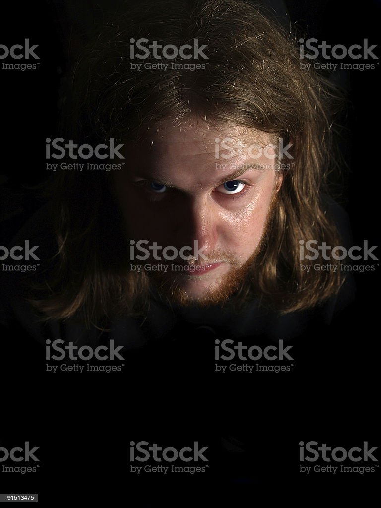 scary man with blue eyes royalty-free stock photo