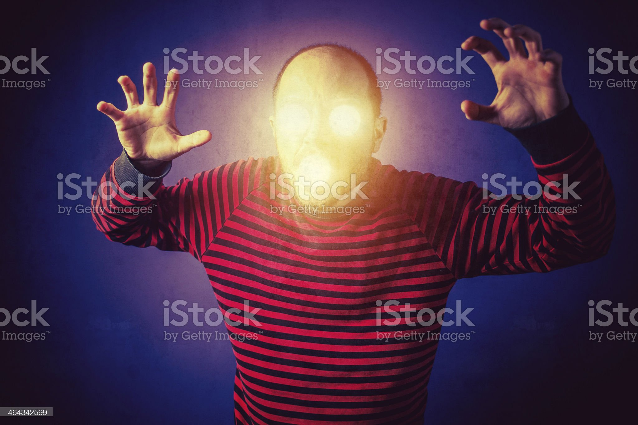 Scary man with luminous eyes royalty-free stock photo