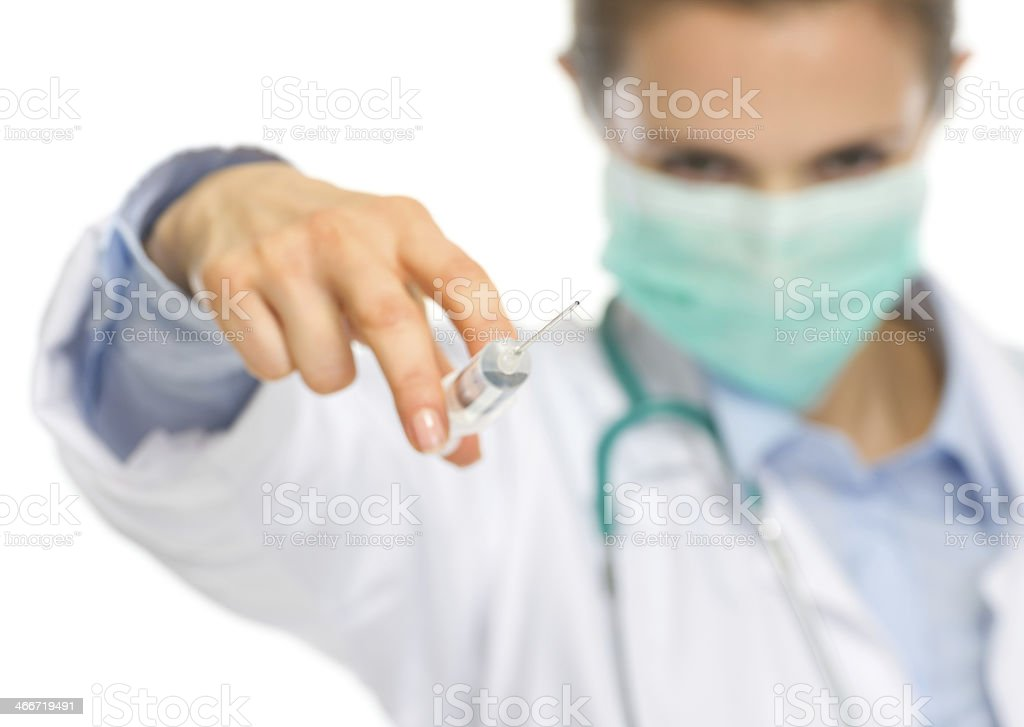 scary medical doctor woman in mask using syringe royalty-free stock photo