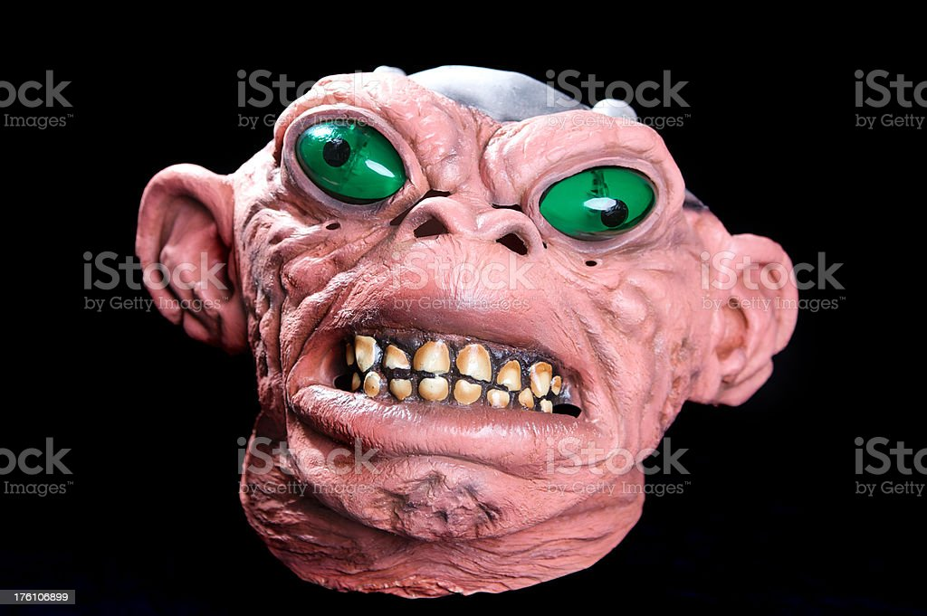 Scary Monster Mask on Black Background for Halloween royalty-free stock photo