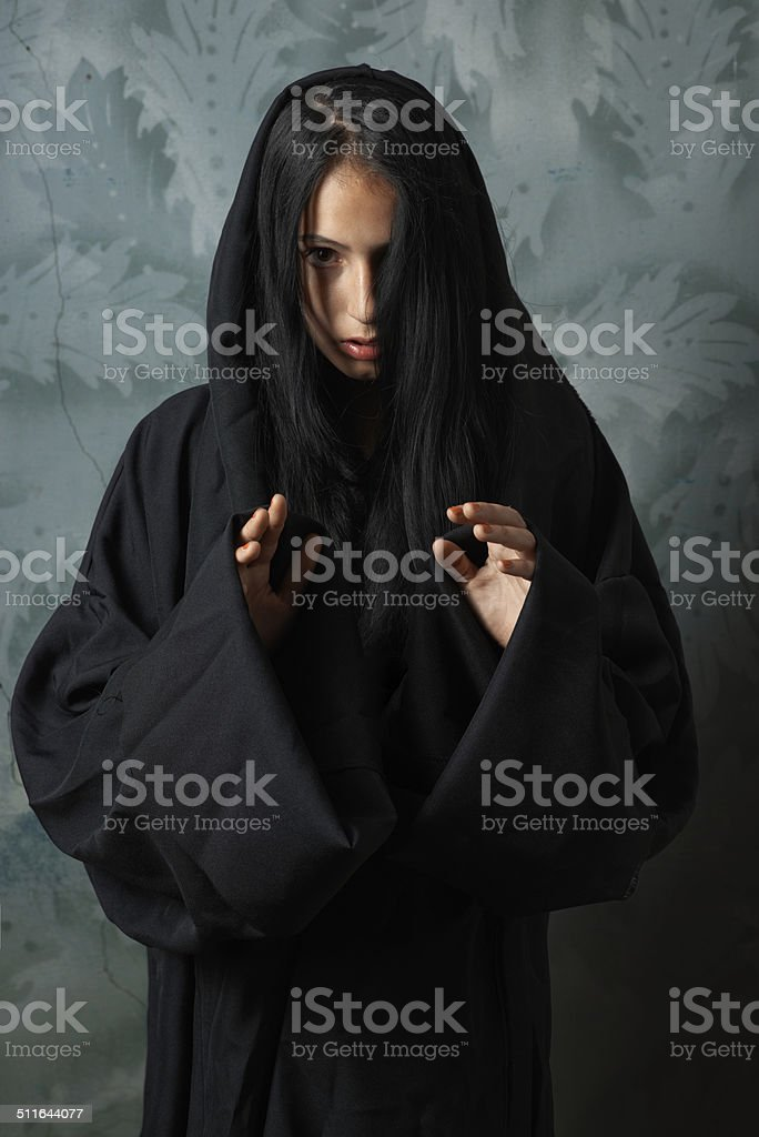 scary nun in a cape stock photo