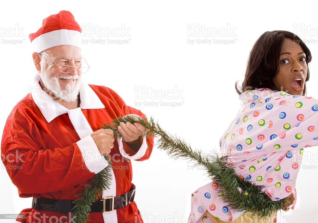 Scary Santa has Captured Young Black Woman with Christmas Garland royalty-free stock photo