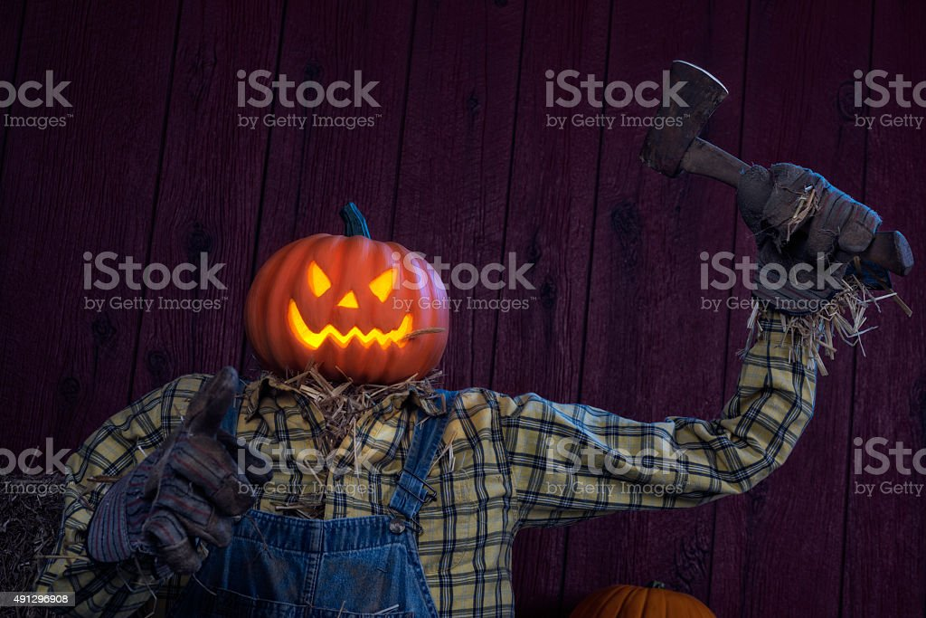 Scary Scarecrow wielding a hatchet stock photo