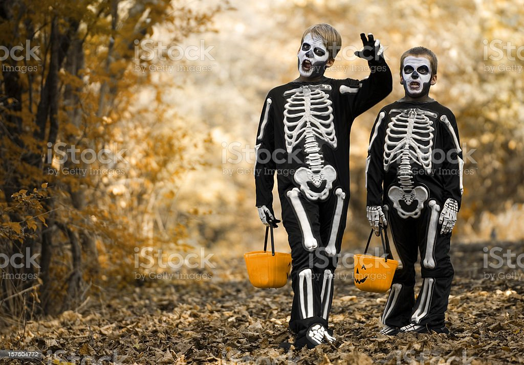 Scary Trick Or Treating Skeletons royalty-free stock photo
