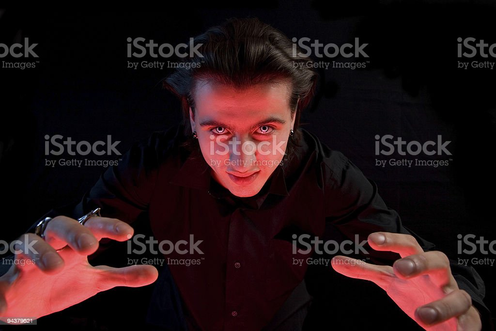 Scary vampire stretching his hands to catch a victim royalty-free stock photo