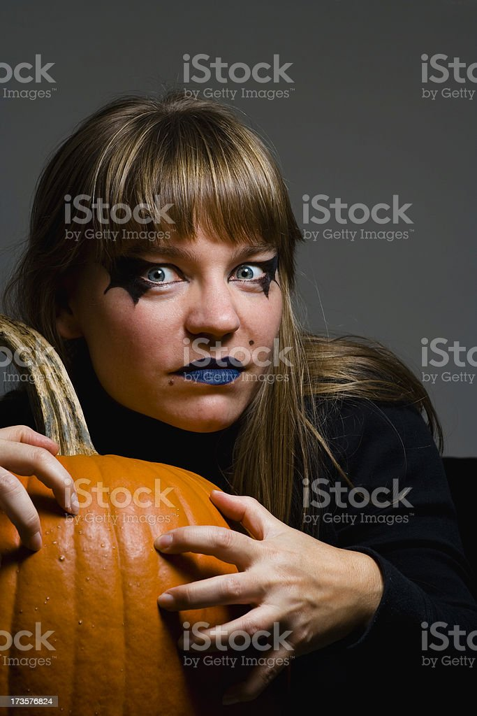 Scary witch with pumpkin stock photo