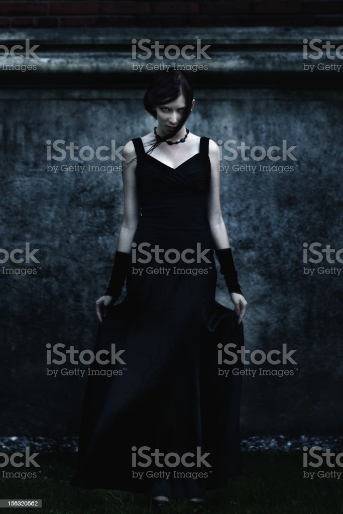 Scary woman in black dress. stock photo