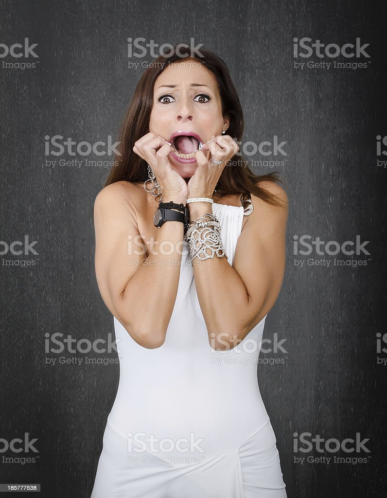 scary woman in gray background royalty-free stock photo