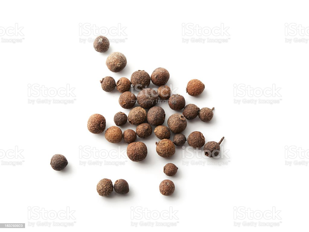 Scattered allspice isolated against a white background royalty-free stock photo