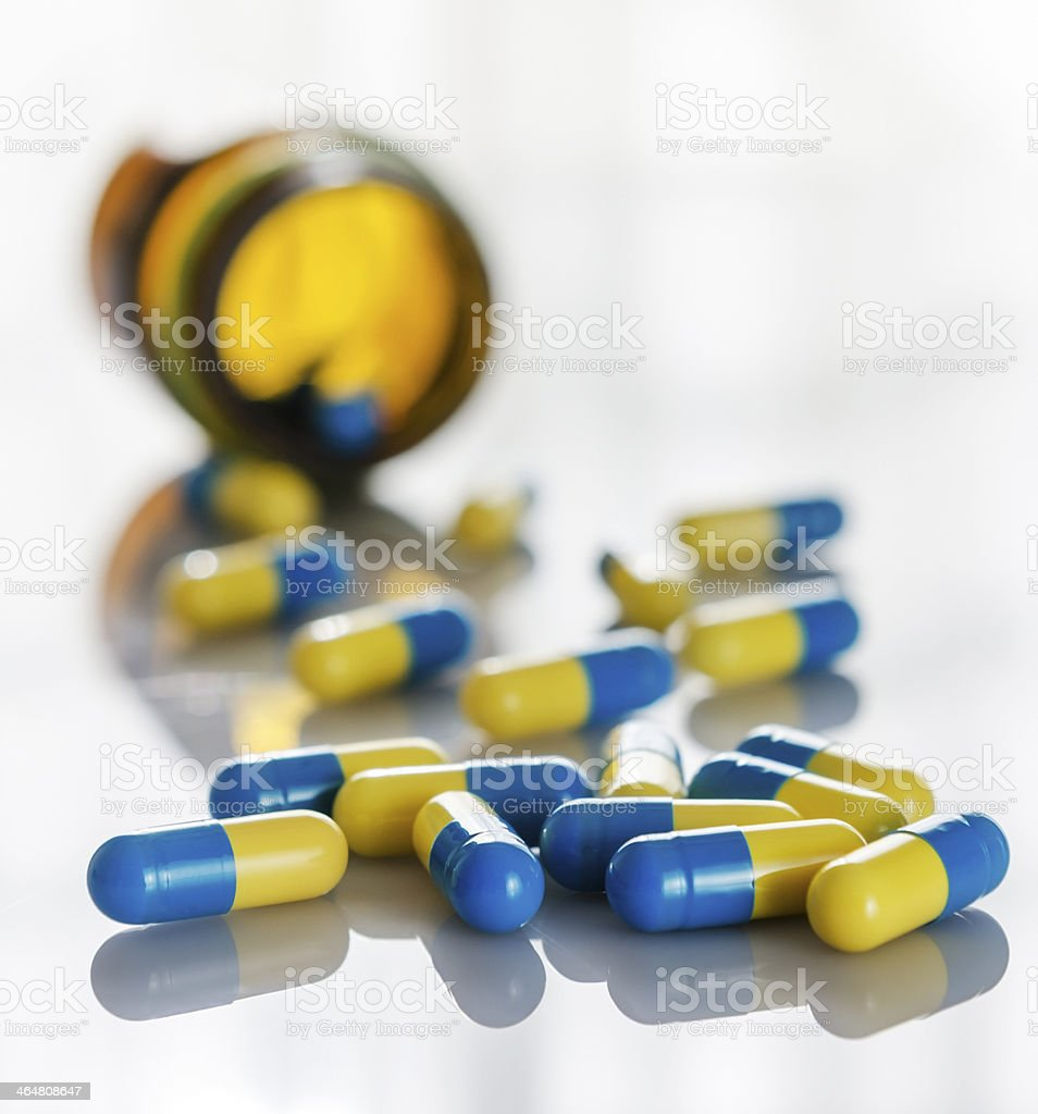 Scattered capsule stock photo