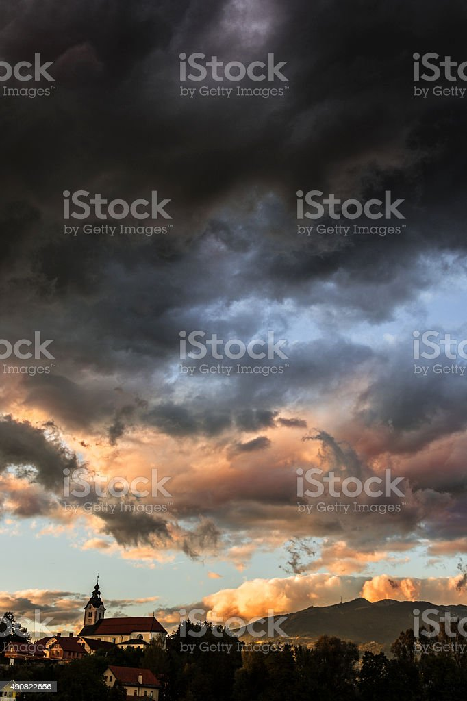 Scattered clouds and warm sun after storm - dramatic sky stock photo