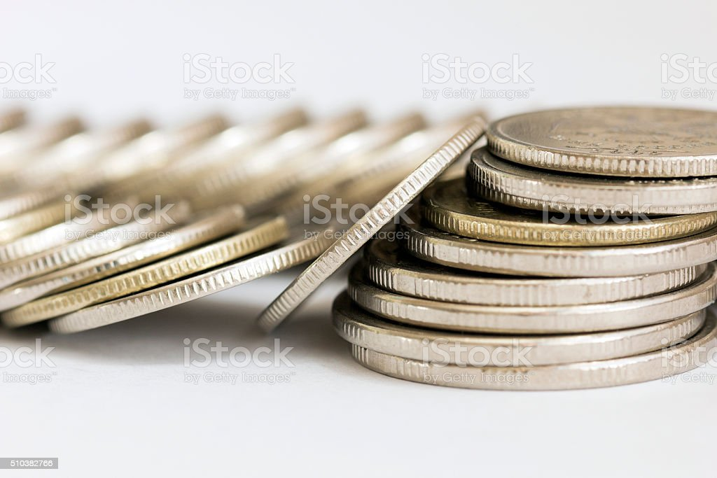 Scattered coins stock photo