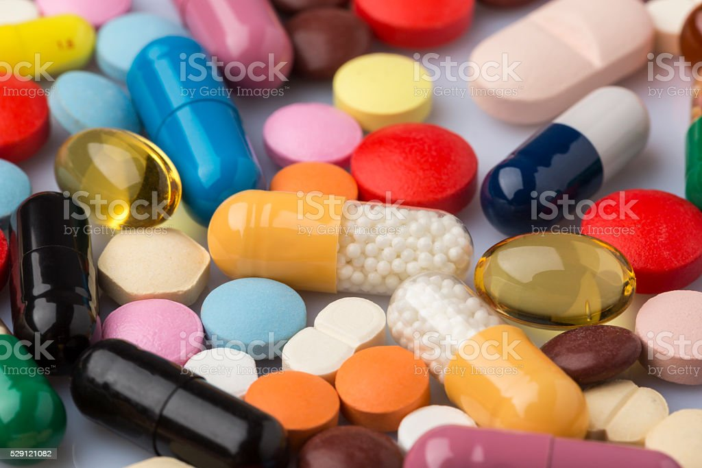 Scattered colorful medical pills and drugs stock photo