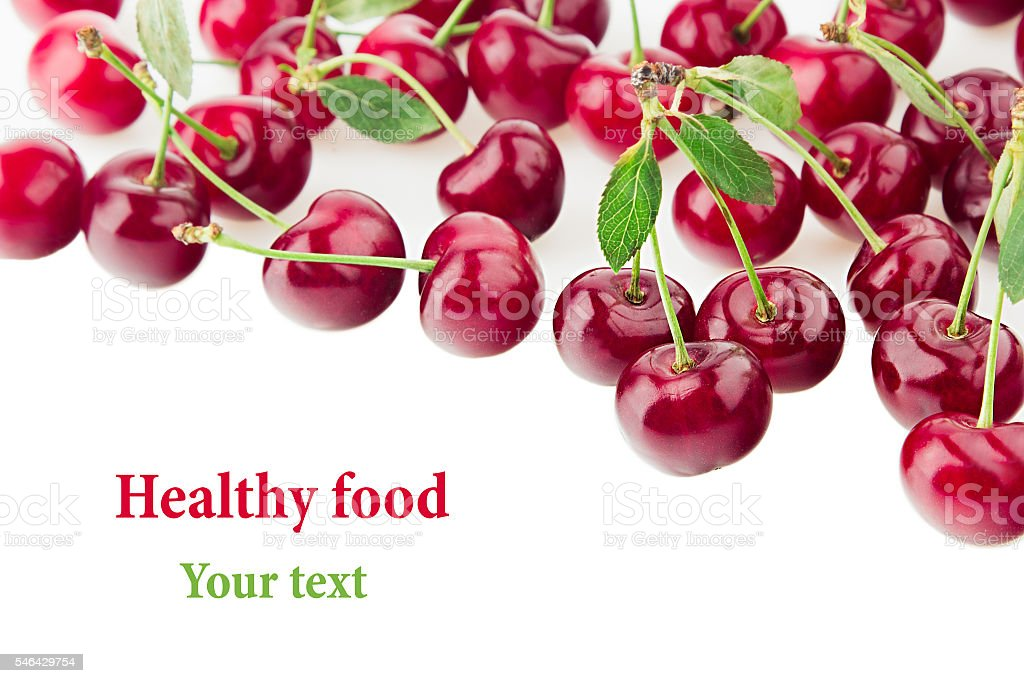 Scattered glossy cherry with tails on a white background. stock photo