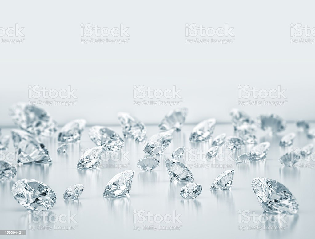 Scattered group of various sized diamonds royalty-free stock photo