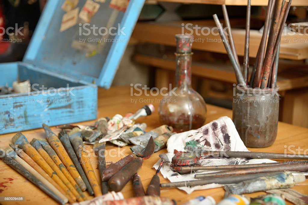 scattered on the table tools of the painter stock photo