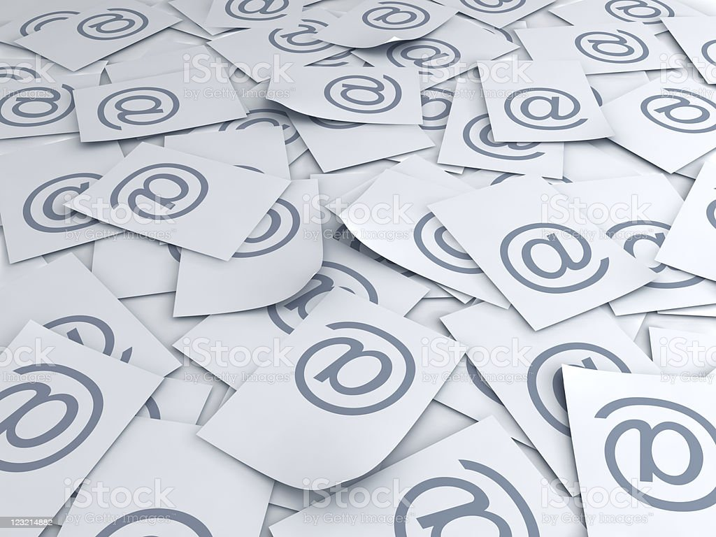 Scattered papers that have the @ symbol on each of them  stock photo