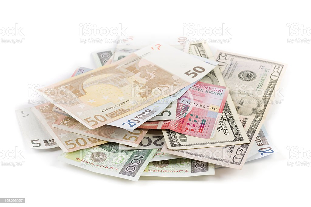 scattered pile of various banknotes isolated on white stock photo