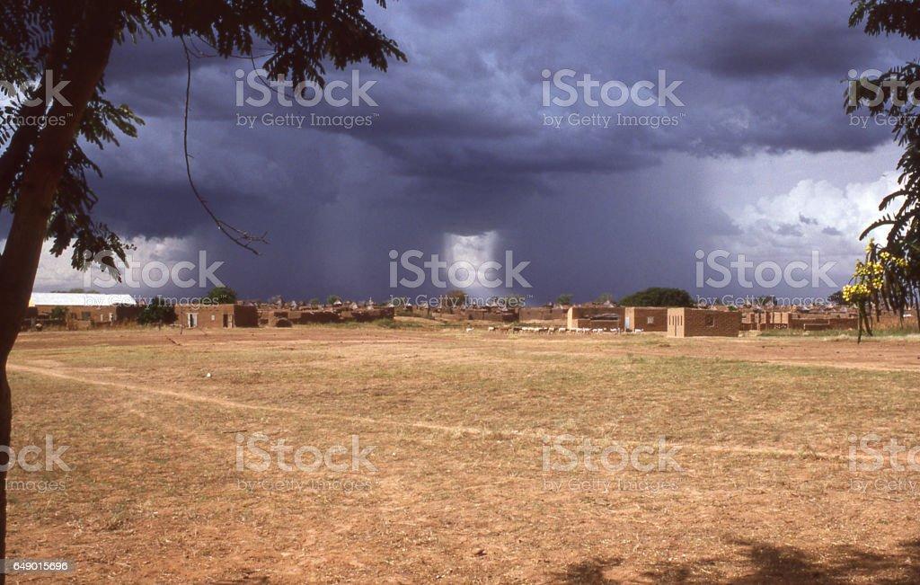 Scattered rain squalls over village of Bahn in northern Yatenga Burkina Faso Africa stock photo