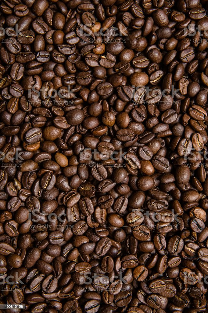 scattered roasted coffee beans stock photo